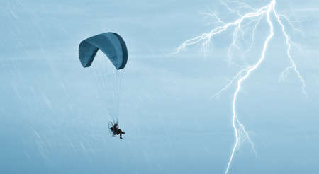 paraglider: Paraglider in flight in the storm in autumn