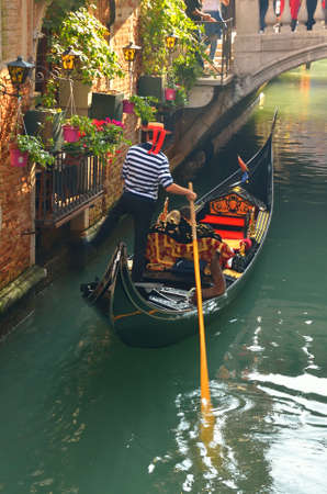 venice canal: Gondola in the canal in Venice,Italy,in summer Stock Photo