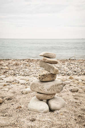 equilibrium: stones in equilibrium on the sand of the beach Stock Photo