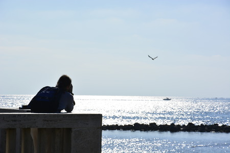 at pontile di ostia a man is taking photos of the sea