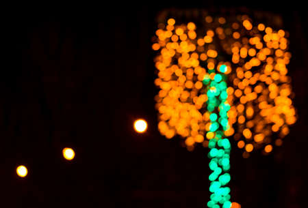 red blur: Colorful beautiful multi-colored Christmas lights on a black background Stock Photo
