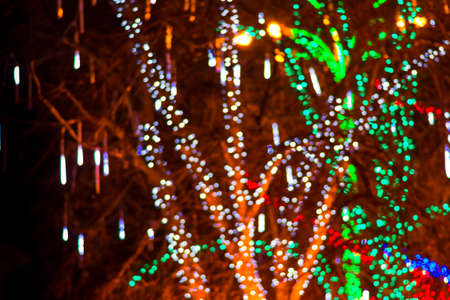 background red: Colorful beautiful multi-colored Christmas blur lights background Foto de archivo