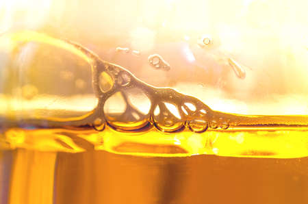 beer bubbles: Beer bubbles in a large bottle close