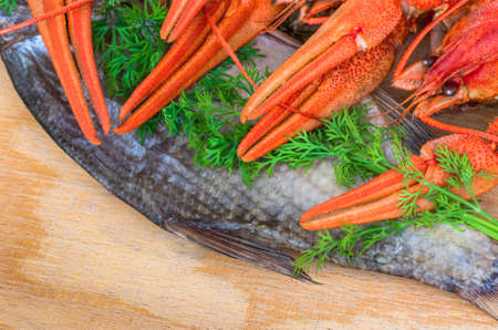 langoustine: Snack for beer crayfish and fish with herbs on a wooden table