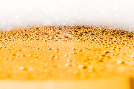 poured: Light beer poured in a glass closeup