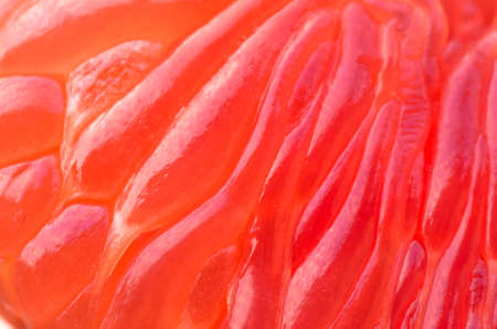 cleaned: cleaned, juicy red inside grapefruit, closeup background
