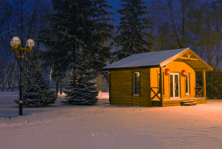 Christmas wooden house Santa Claus at night on the eve of Christmas in the park when the snow fell