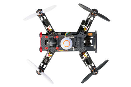 Dron, quad copter Isolated on white background. Remote controlled dron, quadro copter with digital camera. Closeup. New tool for aerial photo and video. 写真素材 - 121329834