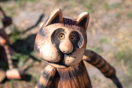 Toy wooden striped cat close up. Toy cat.