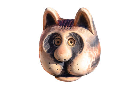 toy wooden head cat closeup, isolated white background.