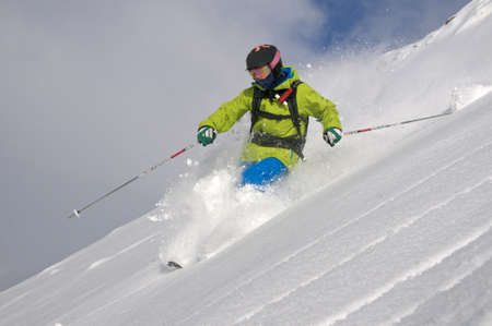 Skiing in deep powder photo