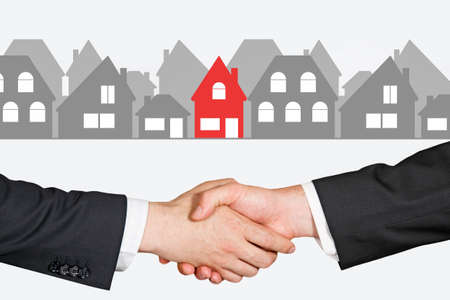 real estate sign: People shaking hands in a real estate transaction