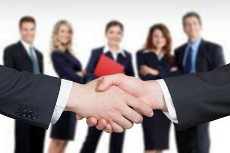 negotiation business: Business handshake and business people Stock Photo