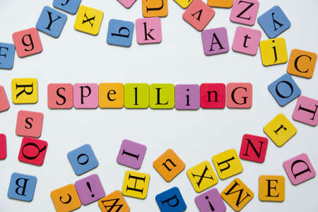 Spelling with toy magnetic letters 스톡 콘텐츠