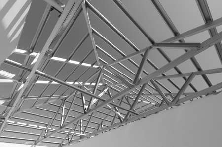 picture person: Structure of steel roof frame for construction.