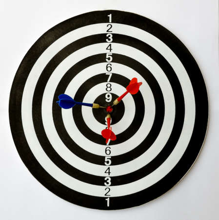 dartboard: Dartboard with three darts on the bulls eye.