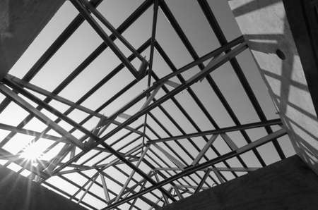 white metal: Structure of steel roof frame for construction. In Black and White.