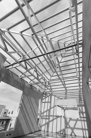 prefabricated house: Structure of steel roof frame for construction.In Prefabricated House system. Stock Photo