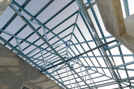 building work: Structure of steel roof frame for building construction. Stock Photo