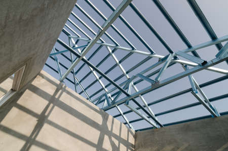 prefabricated buildings: Structure of steel roof frame for building construction. Stock Photo