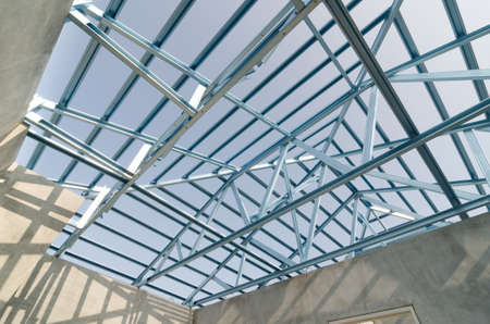 prefabricated house: Structure of steel roof frame for building construction. Stock Photo