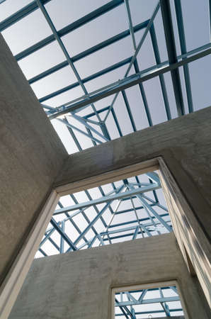 prefabricated building: Structure of steel roof frame for building construction. Stock Photo