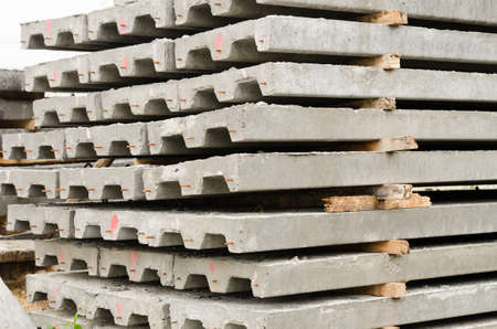 prefabricated building: Concrete slabs used for construction job. Stock Photo