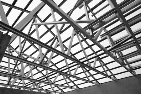 metal structure: Black and white photo,Structure of steel roof frame for construction.
