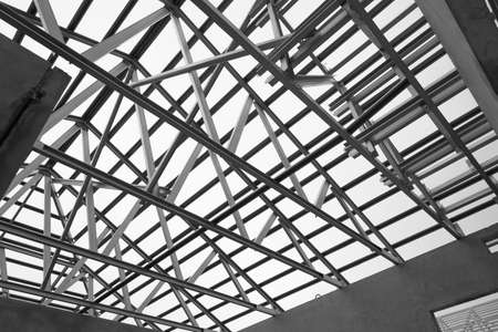 prefabricated building: Black and white photo,Structure of steel roof frame for construction.