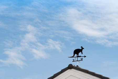 north arrow: Weathervane with kangaroo above an arrow and the four cardinal points North East West South Stock Photo