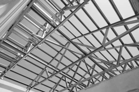 prefabricated building: Black and white photo,Structure of steel roof frame for building construction.The advantage of this structure is lightweight but strong.
