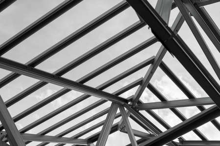 prefabricated building: Black and white photo,Structure of steel roof frame for building construction.