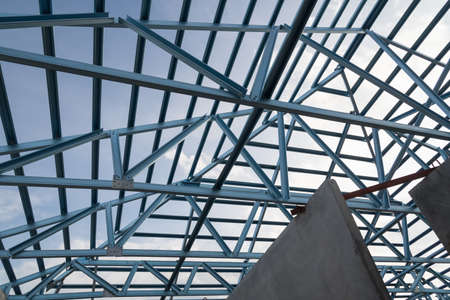 prefabricated building: Structure of steel roof frame for building construction on sky background.