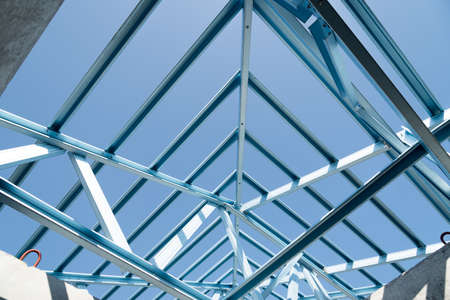 galvanized: Structure of steel roof frame for building construction on sky background.