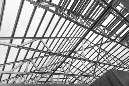 prefabricated buildings: Black and white photo,Structure of steel roof frame for building construction.