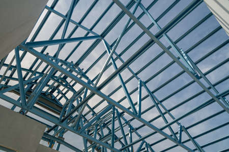 precast: Structure of steel roof frame for building construction on sky background.