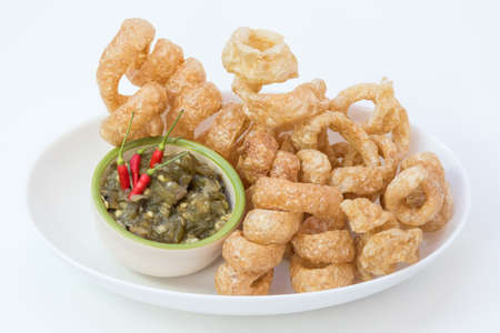 Fried pork rinds with green chili dip(Nam Prik Num)  Local food in Northern Thailand.