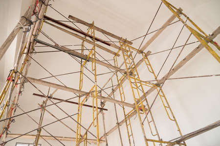 Scaffolding for construction job. Its made us easy to climbing onto a parts of the building. Stock Photo