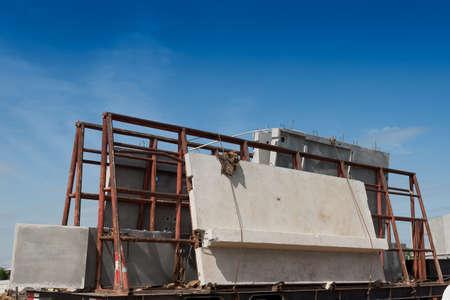 Precast concrete wall panel on the trailer prepare for installation building.