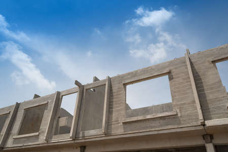 precast: Prefabricated building isolated on blue sky background.