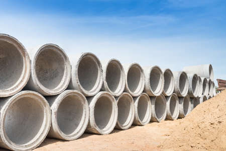 Concrete drainage pipes for industrial building construction.
