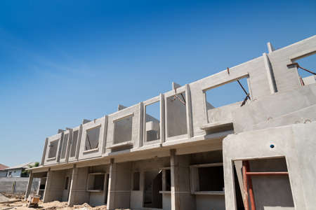 townhomes: Row of Townhouse prefabricated building isolated on blue sky background.