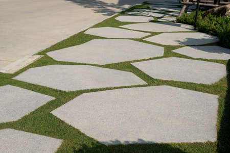 Texture or pattern of paving walkway background decorated in the park. 스톡 콘텐츠