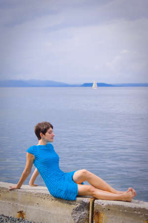 flap: Woman on coast of sea
