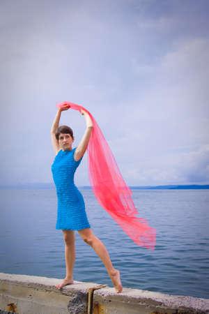 Woman on coast of sea photo