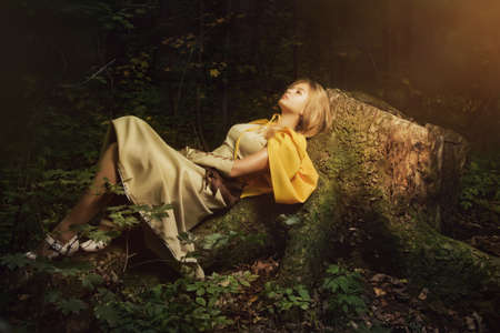 legends folklore: Blond girl in a magic forest Stock Photo