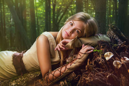 Blond girl in a magic forest Stockfoto