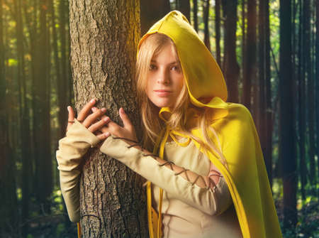 Blond girl in a magic forest 스톡 콘텐츠