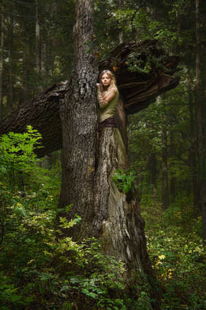 wild hair: Blond girl in a magic forest Stock Photo