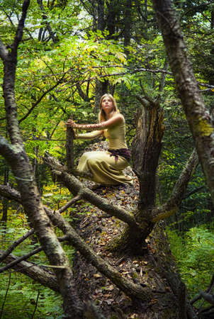 Blond girl in a magic forest Stok Fotoğraf